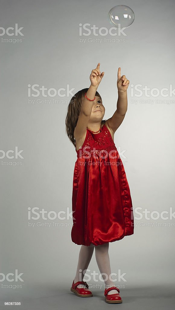 Cute girl playing with soap bubbles royalty-free stock photo