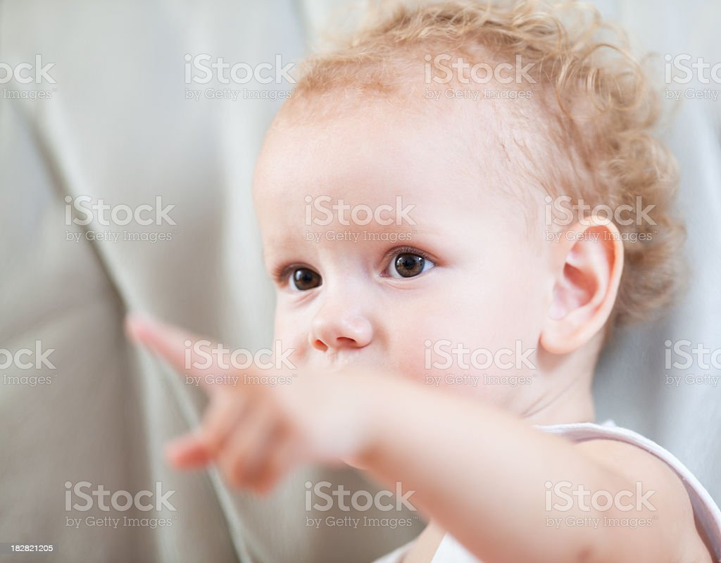 Cute girl pointing royalty-free stock photo