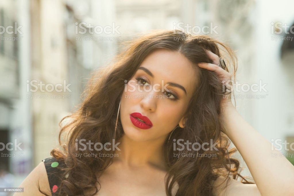 Cute girl posing outdoors and enjoying the summertime. stock photo