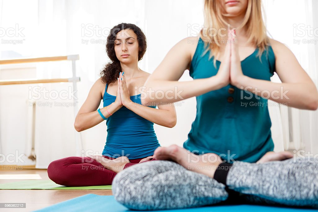Cute girl practice yoga, meditating and relaxing in Lotus position royalty-free stock photo