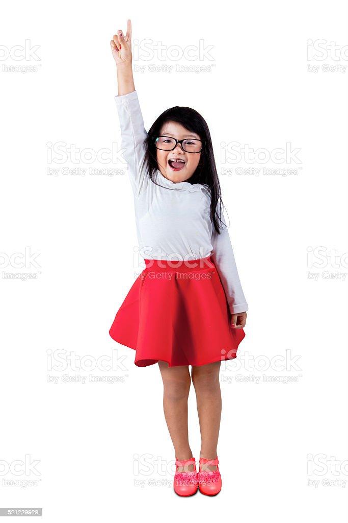 Cute girl raises hand in class stock photo