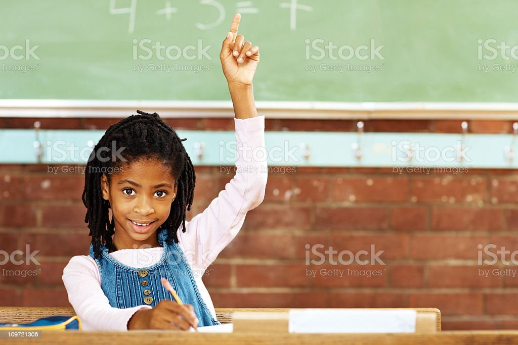Cute girl raising hand to answer the question royalty-free stock photo