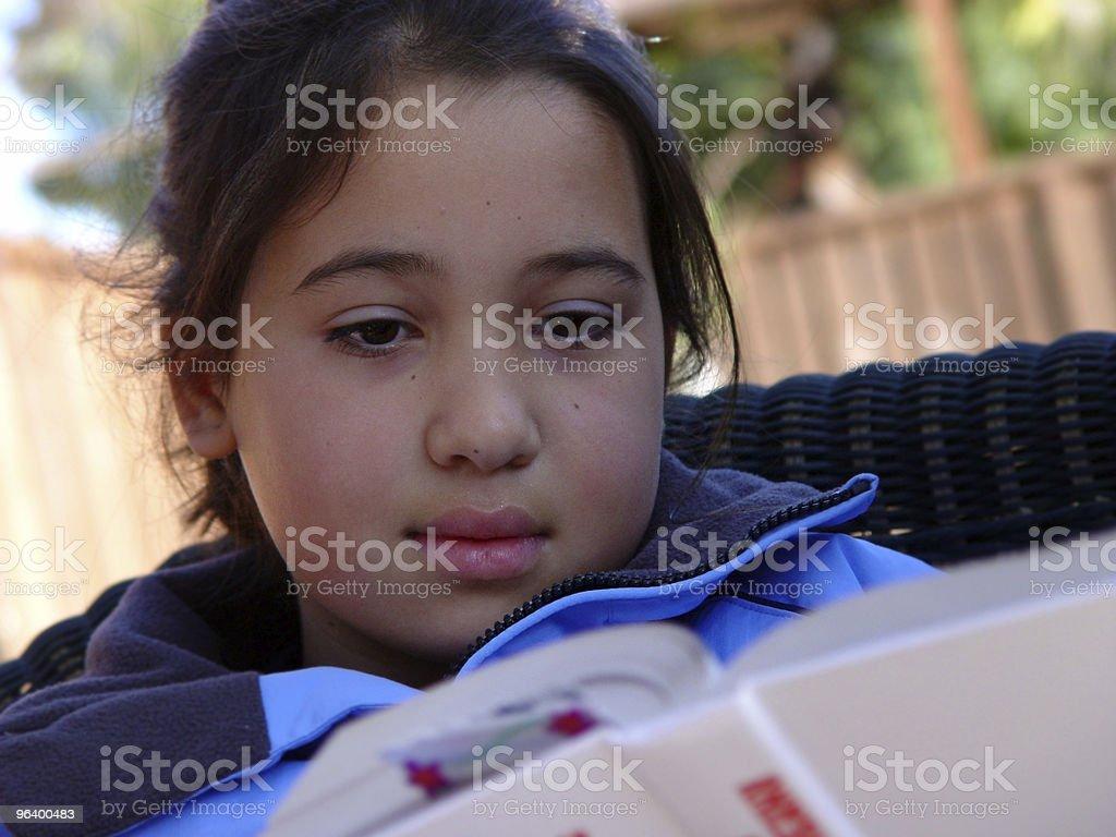 Cute girl reading - Royalty-free Adolescence Stock Photo
