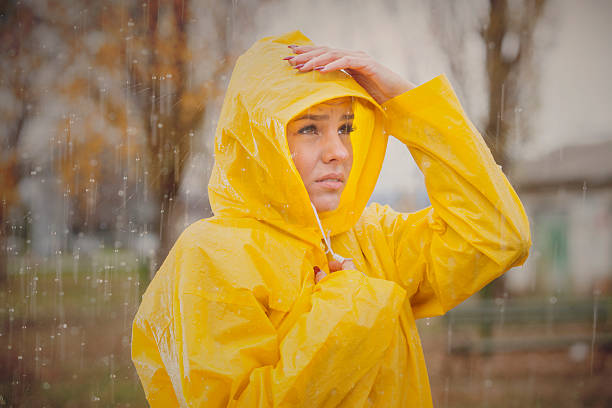 cute girl ready for the rain! - beautiful curvy girls stock photos and pictures