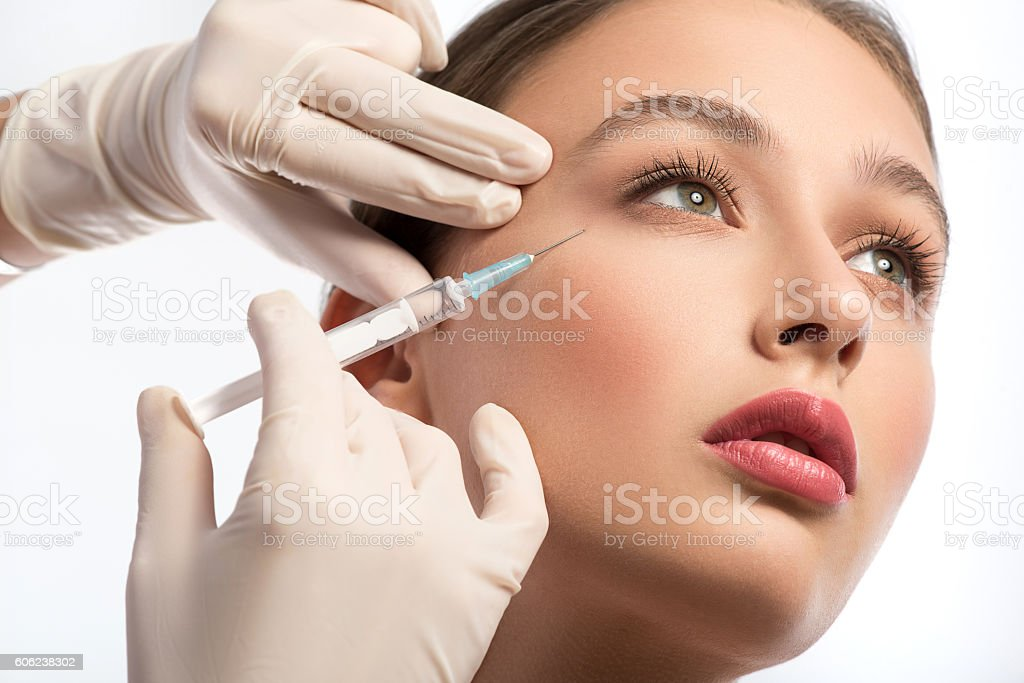 Cute girl receiving hyaluronic acid treatment stock photo
