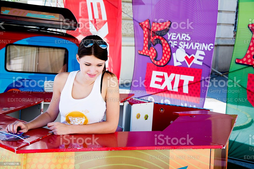 Cute girl selling tickets for EXIT festival 2015 stock photo