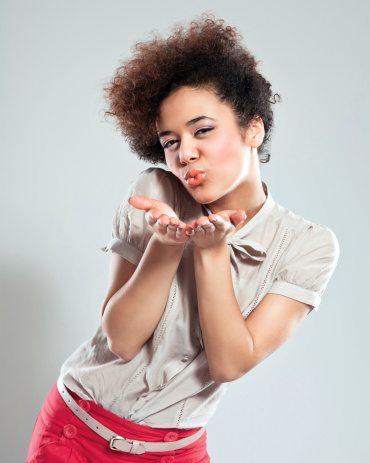 Cute Girl Sending Kiss Stock Photo - Download Image Now
