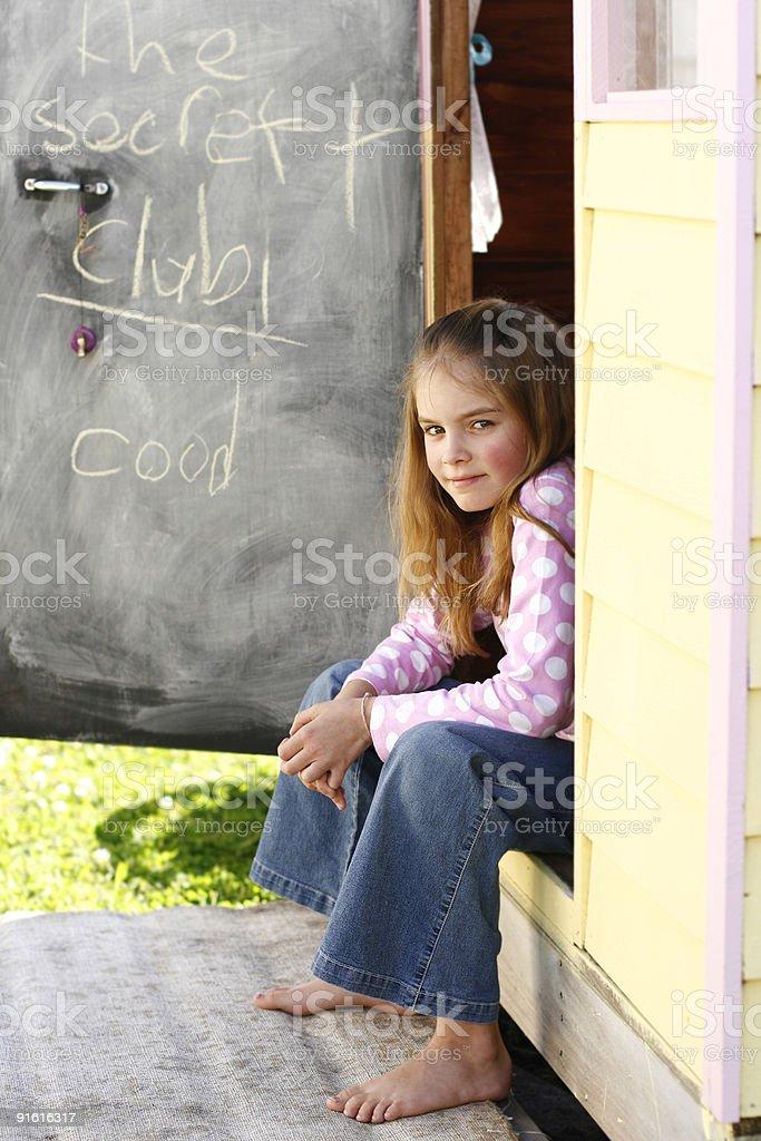 Cute girl sitting looking at camera royalty-free stock photo