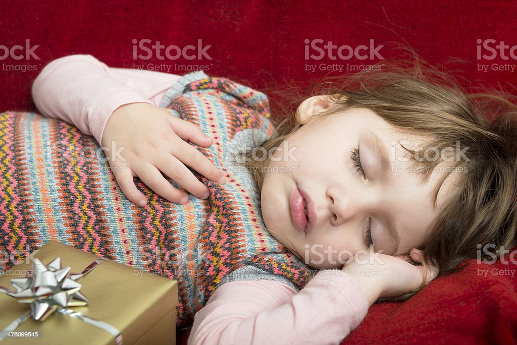 Cute Girl Sleeping, Christmas Presents, Europe royalty-free stock photo