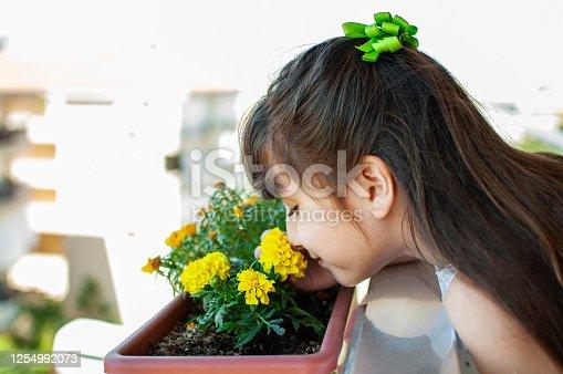 Turkish little girl enjoying blooming aroma