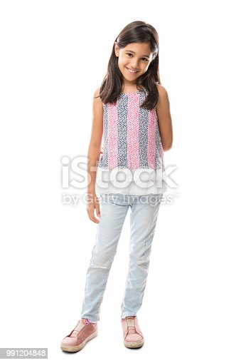 Full length image of Happy young latin girl in jeans and top posing and looking at the camera over white background
