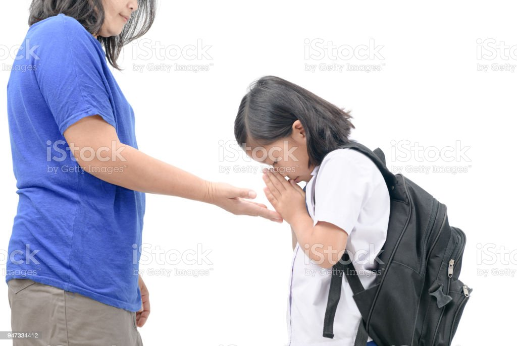 cute girl student pay respect or sawasdee to her mother stock photo