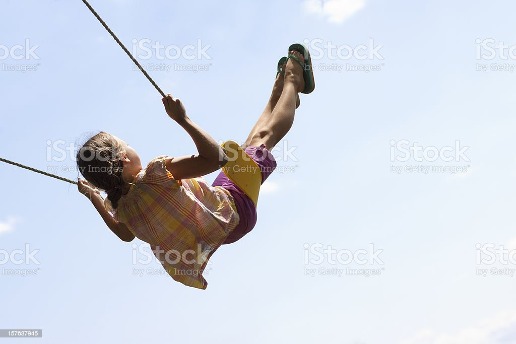 Cute Girl Swinging High in Air 2 stock photo