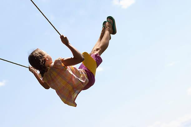 Cute Girl Swinging High in Air 2 stock photo