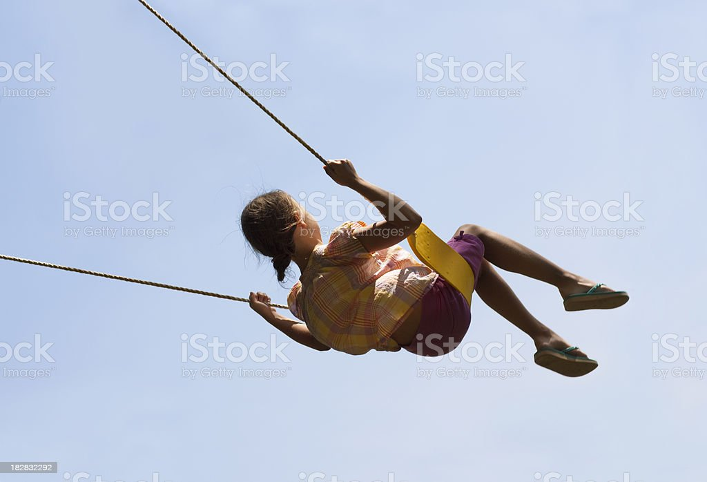 Cute Girl Swinging High in Air stock photo