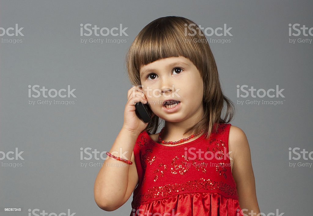 Cute girl taking on the phone royalty-free stock photo