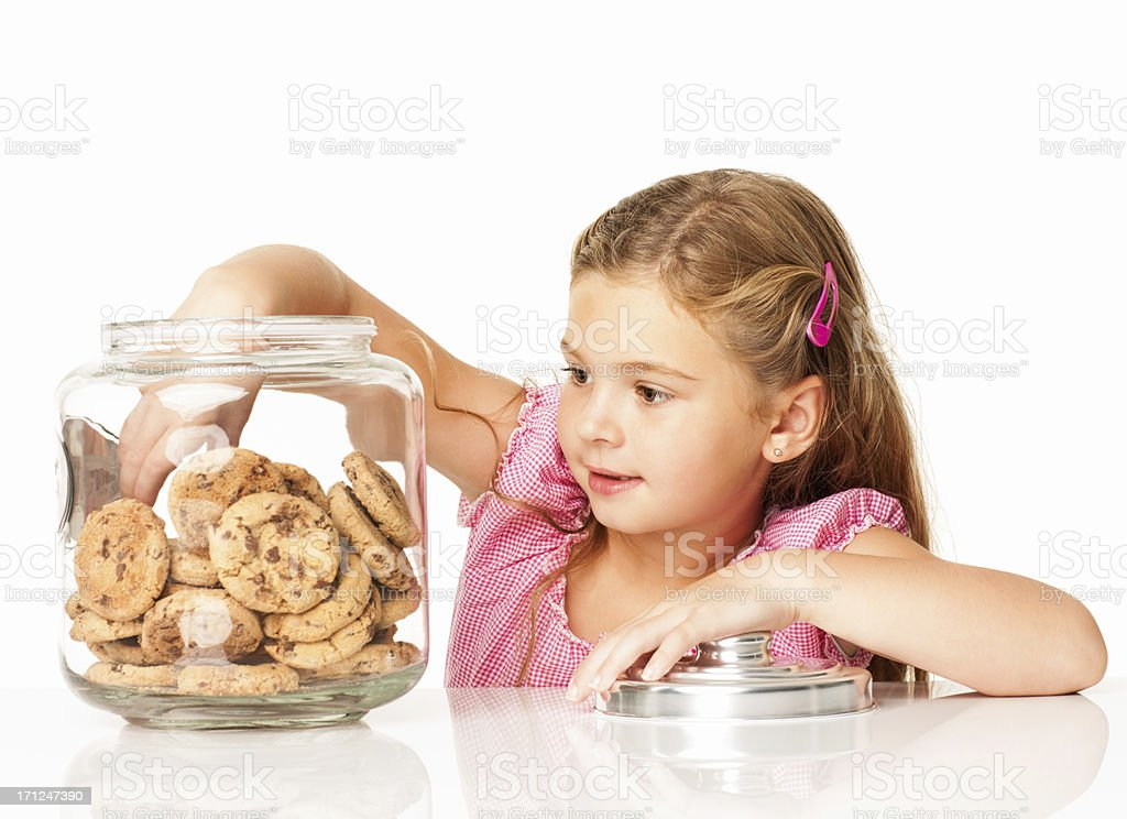 Cute Girl Taking Out Chocolate Chip Cookie - Isolated royalty-free stock photo
