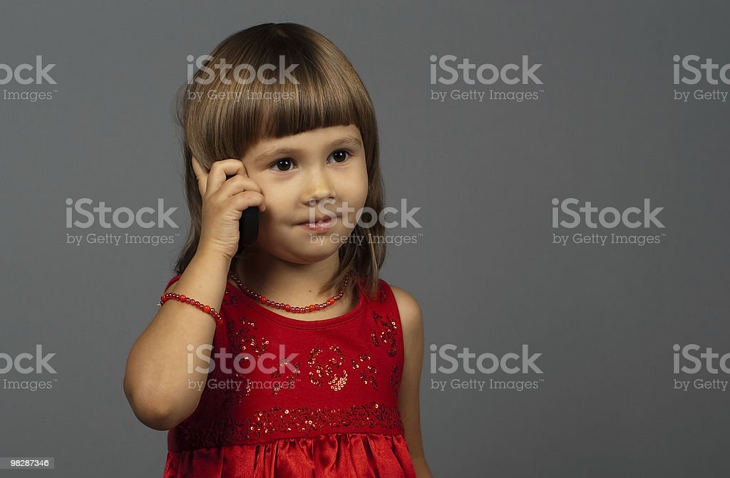 Cute girl talking on the phone royalty-free stock photo