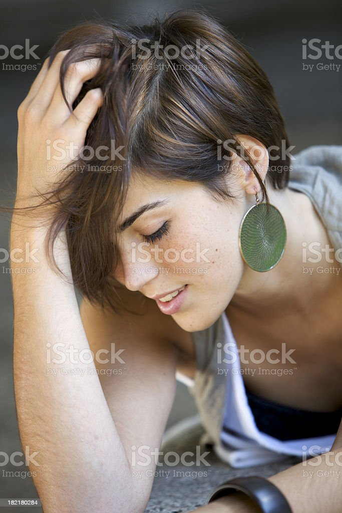 Cute girl touching hair stock photo