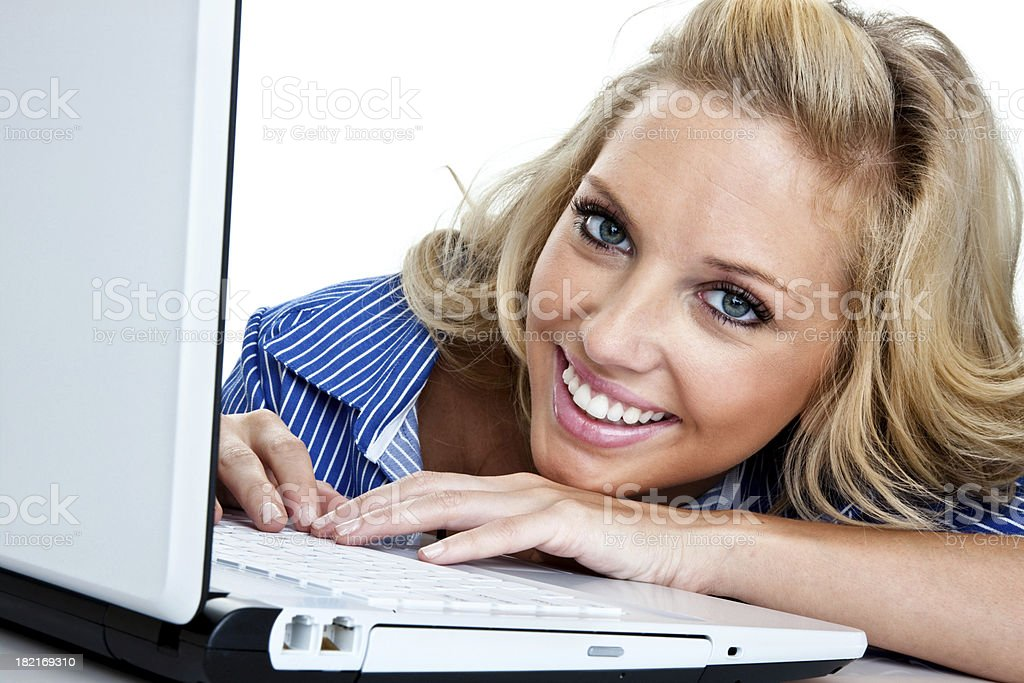 Cute girl using a notebook computer royalty-free stock photo