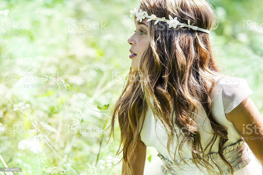 Cute girl wearing headband in field. stock photo