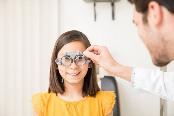 Cute girl wearing trial frame in ophthalmology clinic picture id1011970726?b=1&k=6&m=1011970726&s=612x612&w=0&h=mxddlmgcgix1fngcsaufs69ojslg2lodiyjcvihz0ym=