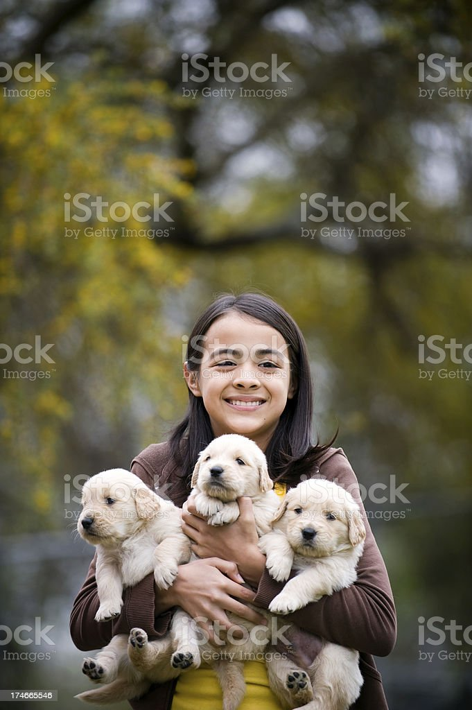 Cute girl whit her puppies royalty-free stock photo