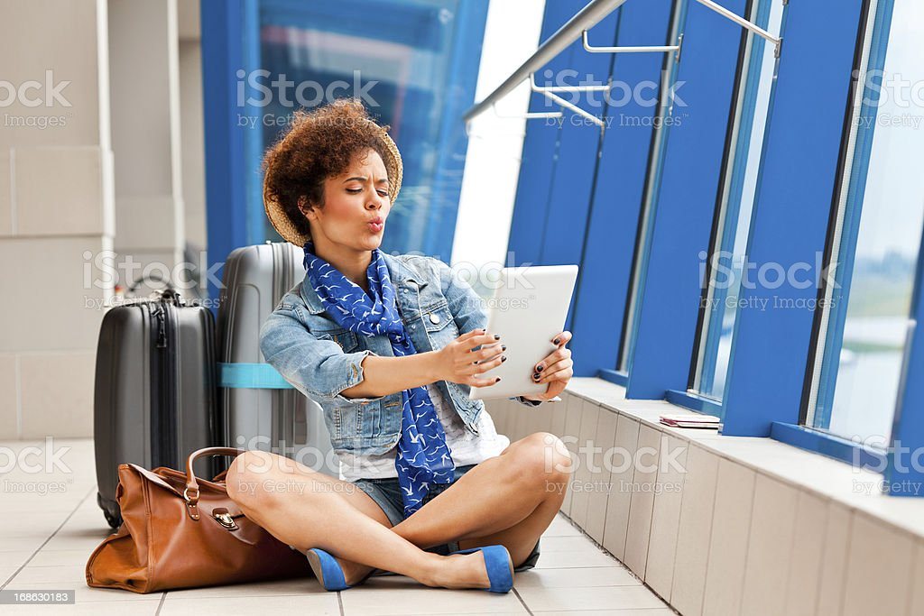 Cute girl with a digital tablet at the airport royalty-free stock photo