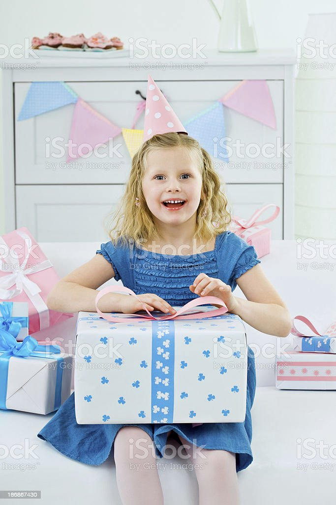Cute girl with birthday present royalty-free stock photo