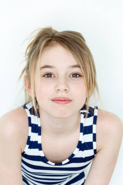 Cute girl with blond long hair stock photo