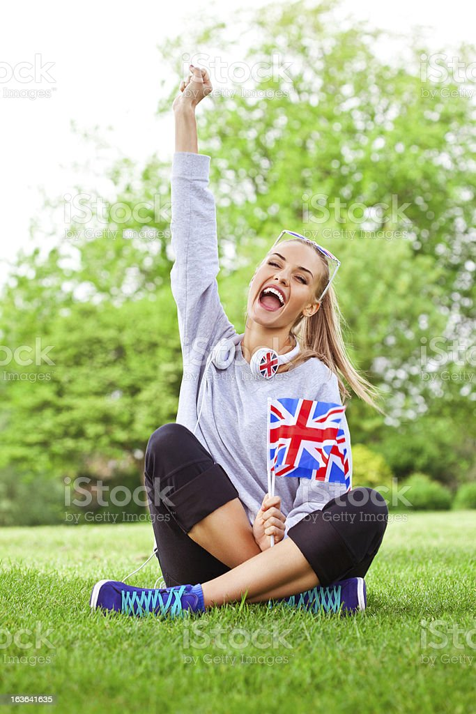 Cute girl with british flags royalty-free stock photo