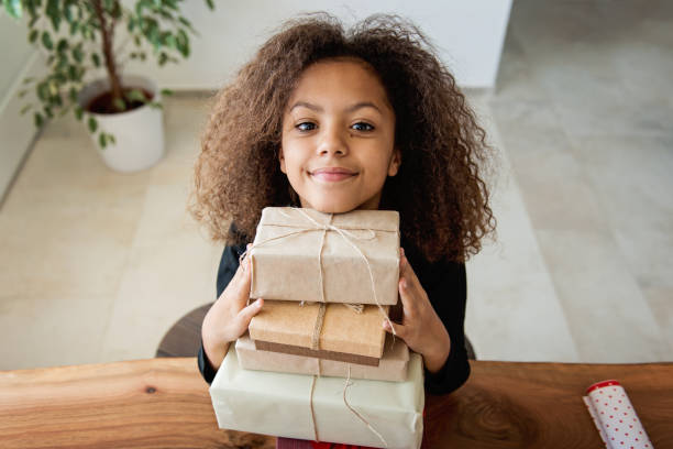 Cute girl with Christmas presents stock photo