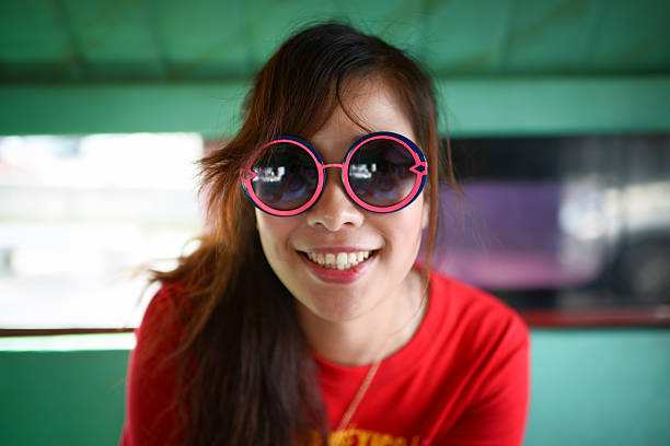 cute girl with funny sunglasses - pics for cool girl stock pictures, royalty-free photos & images
