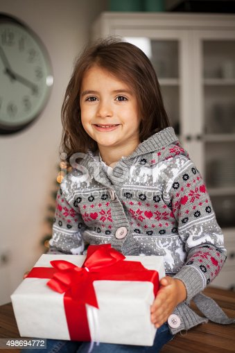 1061876006 istock photo cute girl with gift box 498694772