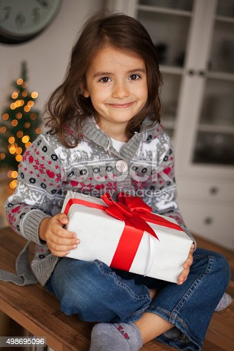 1061876006 istock photo cute girl with gift box 498695096