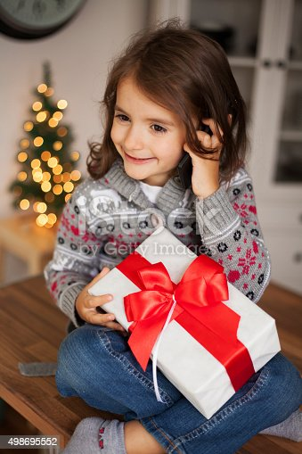 1061876006 istock photo cute girl with gift box 498695552