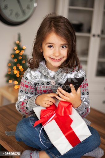 1061876006 istock photo cute girl with gift box 498696026
