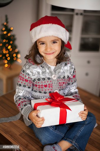 1061876006 istock photo cute girl with gift box 498696224