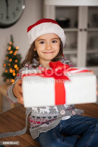 1061876006 istock photo cute girl with gift box 498696442