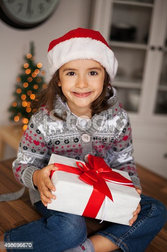 1061876006 istock photo cute girl with gift box 498696670