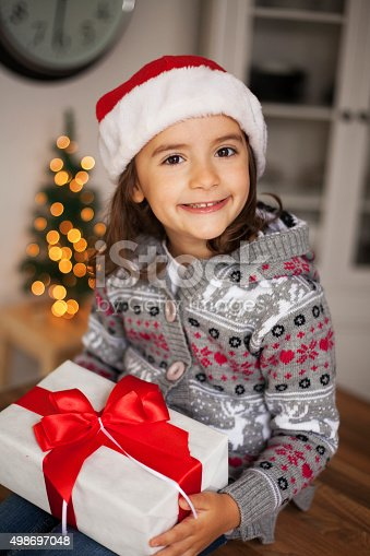 1061876006 istock photo cute girl with gift box 498697048