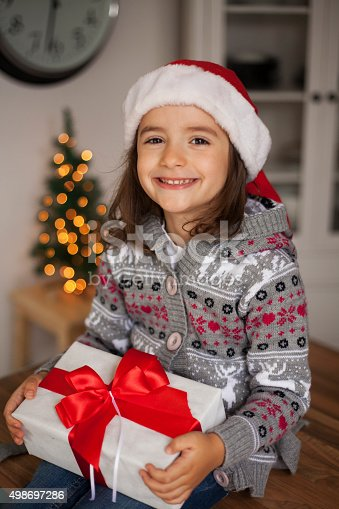 1061876006 istock photo cute girl with gift box 498697286