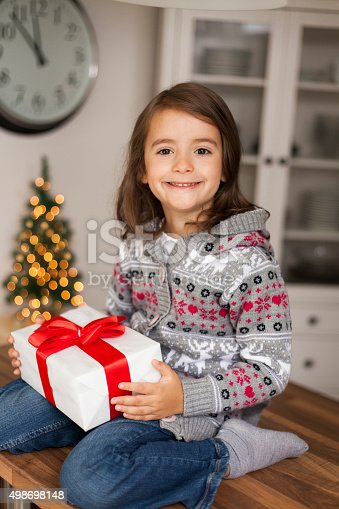 1061876006 istock photo cute girl with gift box 498698148