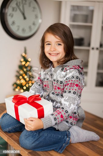 1061876006 istock photo cute girl with gift box 498698366