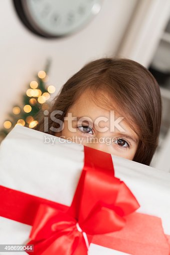 1061876006 istock photo cute girl with gift box 498699044