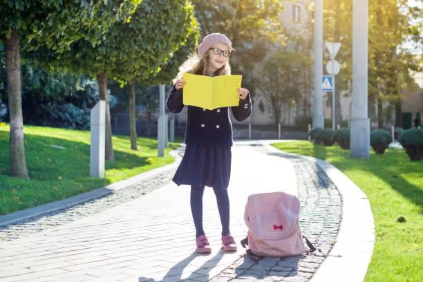 a3fc2c06b1 Royalty Free Little Girl Walks To School Alone In The Street ...