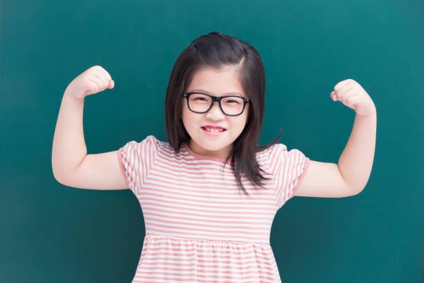 cute girl with green chalkboard stock photo