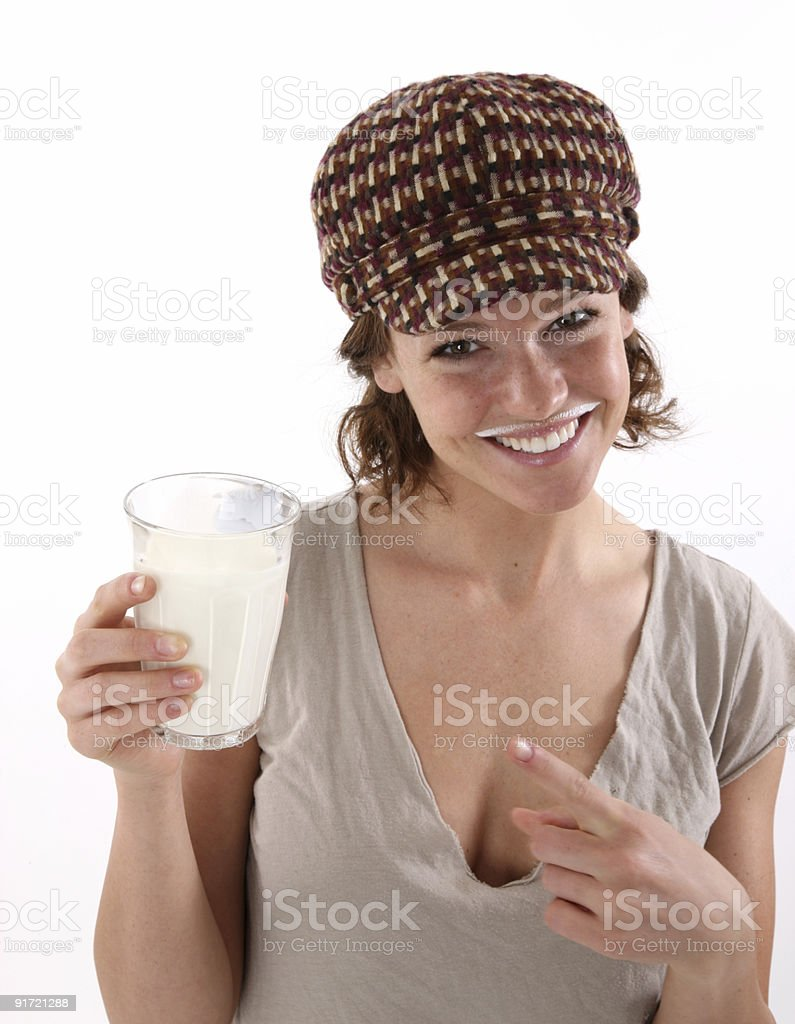 Cute girl with hat drinking milk royalty-free stock photo