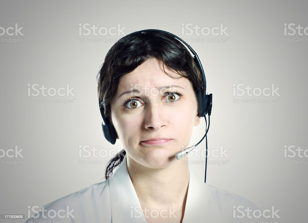 Cute girl with headset, work problems stock photo