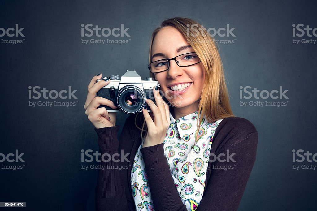Cute girl with her camera stock photo